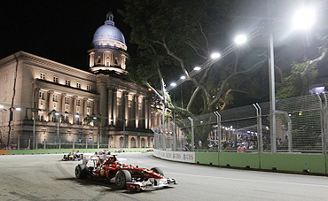 Ferrari Formula One driver Fernando Alonso powers around turn 10 in front of the Old Supreme Courthouse during the Singapore F1 Grand Prix