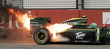 The car of Lotus driver Heikki Kovalainen goes up in flames during the Singapore F1 Grand Prix