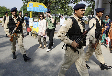 Indian security personnel patrol a shopping arcade ahead of Commonwealth Games in New Delhi