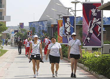 Members of the New Zealand Commonwealth Games team take a walk inside the Games Village