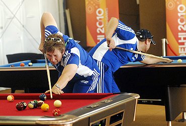 Team members from Scotland play snooker inside the Commonwealth Games Village