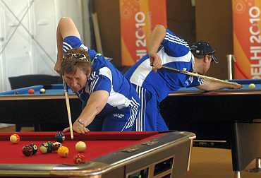 Team members from Scotland play snooker inside the Commonwealth Games athletes village