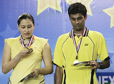 India's Diju and Jwala Gutta with their runners-up medals at the World Super Series badminton tournament in December