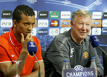 Manchester United's Nani (left) with manager Alex Ferguson