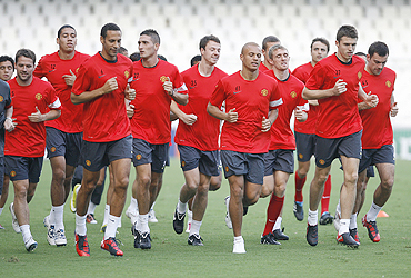 Manchester United players go through the paces during a training session in Valencia