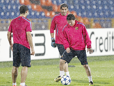 Lionel Messi (right) with teammates at a training session