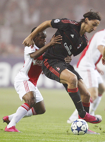 Ajax Amsterdam's Vurnon Anita (left) challenges AC Milan's Zlatan Ibrahimovic during their Champions League Group G match