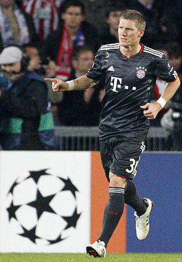 Bayern Munich's Bastian Schweinsteiger celebrates after scoring against FC Basel