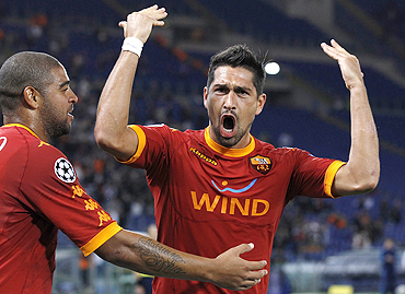 AS Roma's Marco Borriello (right) celebrates with teammate Adriano after scoring against CFR Cluj