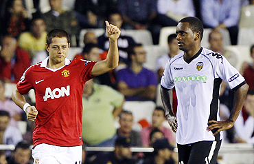 Manchester United's Javier Hernadez (left) celebrates after scoring against Valencia