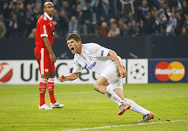 Schalke 04's Klaas-Jan Huntelaar celebrates after netting against Benfica