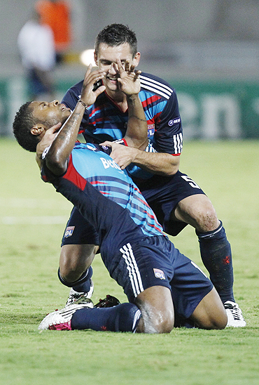 Olympique Lyonnais Michel Bastos (left) celebrates his second goal against Hapoel Tel Aviv