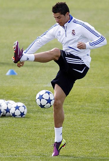 Real Madrid's Cristiano Ronaldo juggles a ball during a training session at the Valdebebas training grounds outside Madrid