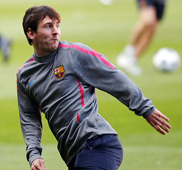 Barcelona's Lionel Messi attends a training session at Nou Camp