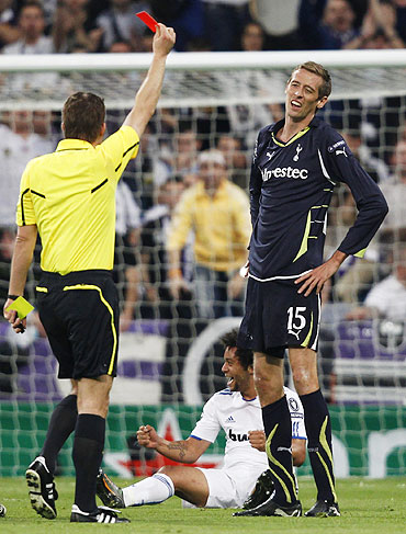 Tottenham Hotspur's Peter Crouch (right) receives the matching orders from referee Felix Brych of Germany