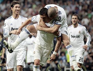 Real Madrid's Cristiano Ronaldo (centre) is congratulated by teammates Pepe and Sergio Ramos (left) after scoring against Tottenham Hotspur