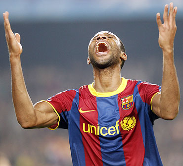 Barcelona's Seydou Keita celebrates after scoring against Shakhtar Donetsk