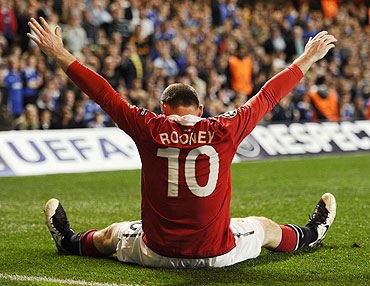Manchester United's Wayne Rooney celebrates after scoring against Chelsea