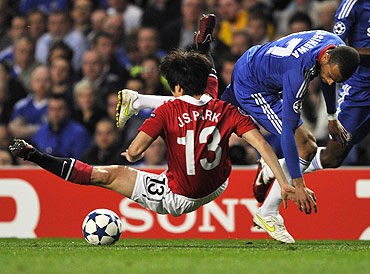 Manchester United's Park Ji-Sung is tackled by Chelsea's Ashley Cole (right)
