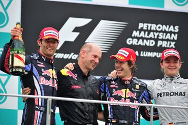 Race winner Sebastian Vettel (2nd right) celebrates on the podium with second placed team mate Mark Webber (left) and Red Bull Racing and Red Bull Racing Chief Technical Officer Adrian Newey (2nd left) and third placed Nico Rosberg (right)  following the Malaysian GP last year.