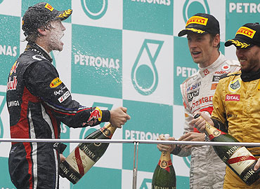 Sebastian Vettel (left) celebrates with Jenson Button and Nick Heidfeld on the podium