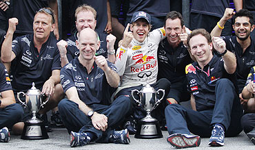 Red Bull's Sebastian Vettel (centre) celebrates with his team after winning the Malaysian F1 Grand Prix on Sunday