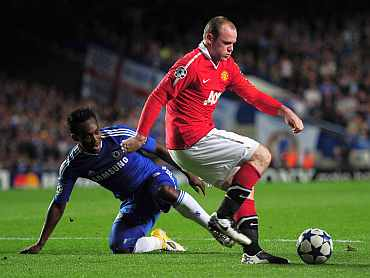Wayne Rooney and Michael Essien