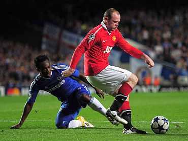 Wayne Rooney and Michael Essien