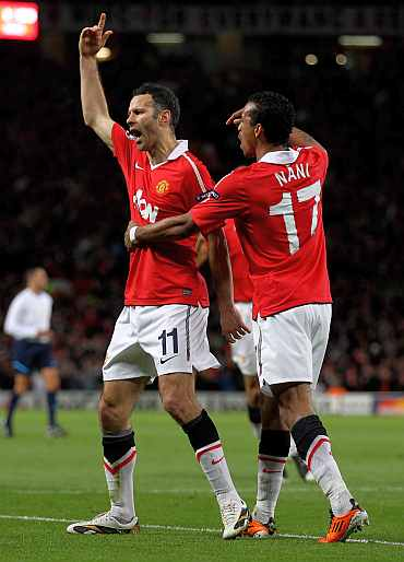 Manchester United's Ryan Giggs and Nani celebrate a goal against Chelsea