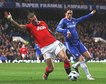 Chelsea's Fernando Torres is challenged by Manchester United's Vidic