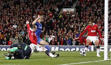 Manchester United's Javier Hernandez scores against Chelsea