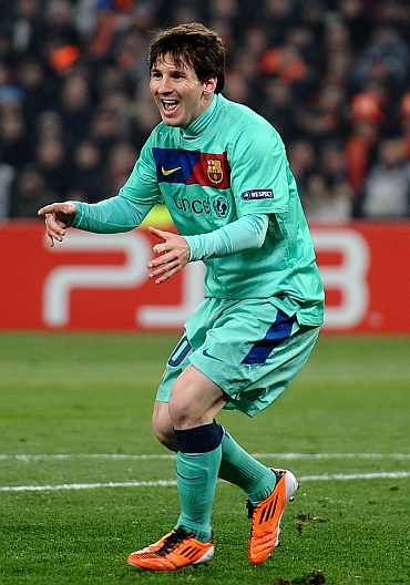 Lionel Messi celebrates after scoing against Shakhtar