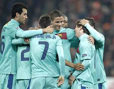 Barcelona players celebrate after winning the match against Shaktar