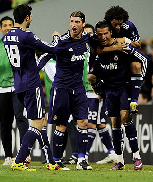 Real Madrid's Cristiano Ronaldo (right) celebrates with teammates after scoring against Tottenham Hotspur on Wednesday
