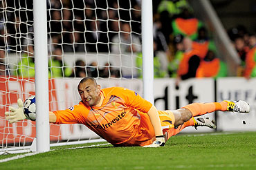 Tottenham goalkeeper Heurelho Gomes fails to stop a Cristiano Ronaldo from scoring Real Madrid's first goal