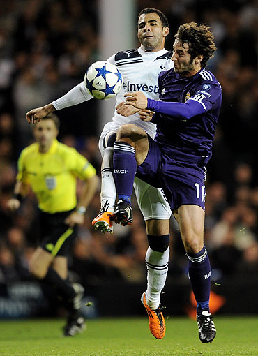 Sandro of Spurs fights for possession with Esteban Granero of Real Madrid