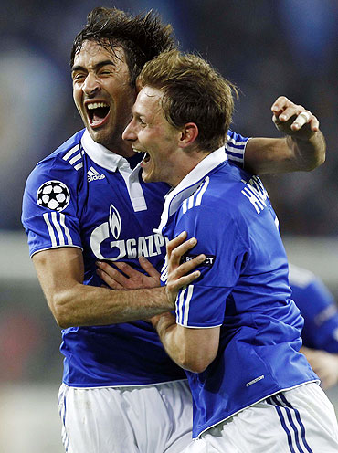 Raul Gonzalez (left) and Benedikt Hoewedes of Schalke 04 celebrate after scoring
