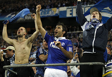 Raul Gonzalez (centre) celebrates with Schalke 04 supporters after the match against Inter