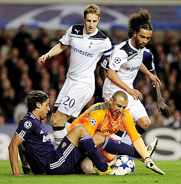 Tottenham 'keeper Heurelho Gomes tries to make a save from Real Madrid's Samir Khedira