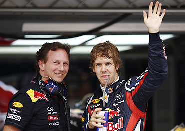 Red Bull's Sebastian Vettel (right) with team principal Christian Horner after the second practice session in Shanghai on Friday