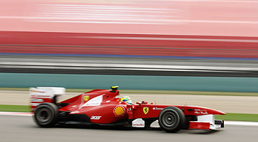 Ferrari's Felipe Massa drives during practice race of the Chinese GP on Friday