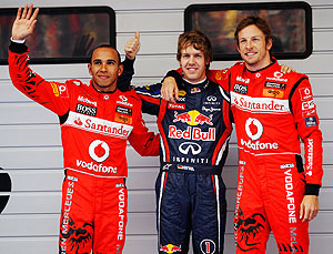 Red Bull's Sebastian Vettel (centre) celebrates with McLaren's Jenson Button (right) ans Lewis Hamilton after taking pole in China on Saturday