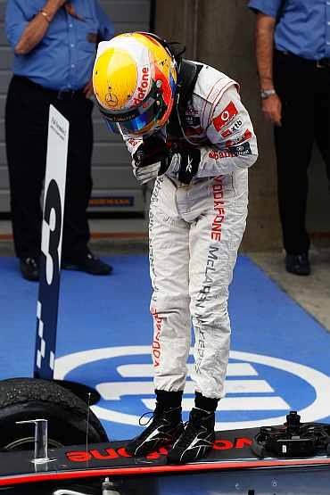 McLaren's Lewis Hamilton reacts after winning the Chinese Formula One Grand Prix at the Shanghai International Circuit