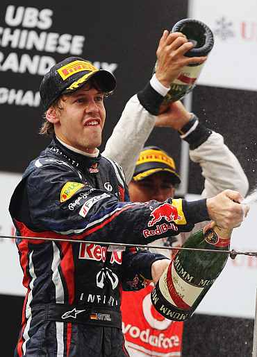 Red Bull's Sebastian Vettel celebrates after the Chinese Formula One Grand Prix at the Shanghai International Circuit