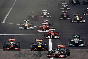 Cars come out of their starting grid during the Chinese Formula One Grand Prix at the Shanghai International Circuit