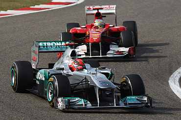 Michael Schumacher drives ahead of Fernando Alonso during the Chinese Grand Prix