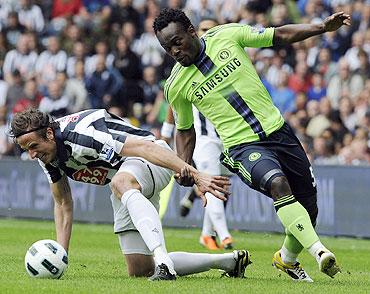 West Bromwich Albion's Jonas Olsson (left) challenges Chelsea's Michael Essien