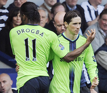 Chelsea's Didier Drogba (left) is substituted by Fernando Torres