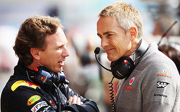 Red Bull Racing Team Principal Christian Horner (left) talks with McLaren Mercedes Team Principal Martin Whitmarsh