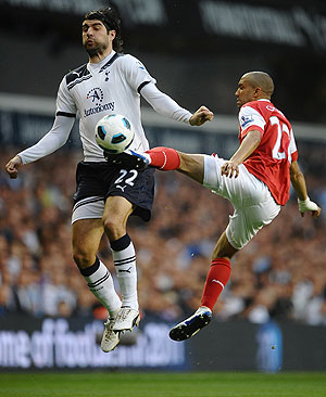 Tottenham's Vedran Corluka (left) is challenged by Arsenal's Gael Clichy during their  EPL match on Wednesday